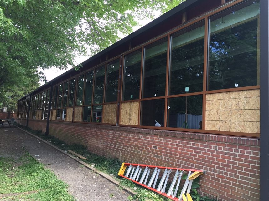 Day 31 of Construction (July 21, 2015) - New windows are being installed this week! Plywood is placeholder until operable window sections are installed.