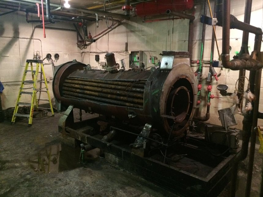 Dismantling of Existing Boiler - Our 1953 boiler, nursed and coaxed into continued operation for decades by alumni parent John Verleun, is no longer in service. On May 18, 2015, Harvey Cleary decommissioned the boiler and started the process of pulling out the boiler, piece by piece.