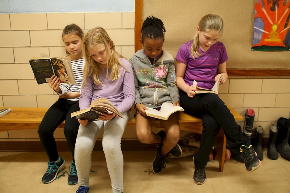 "Fourth-grade students read ""Shiloh"" together. Starting in the third grade, students read books with more advanced vocabulary and sentence structures and with more complex themes."