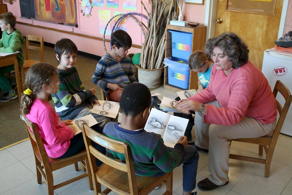A teacher leads a second-grade reading group.