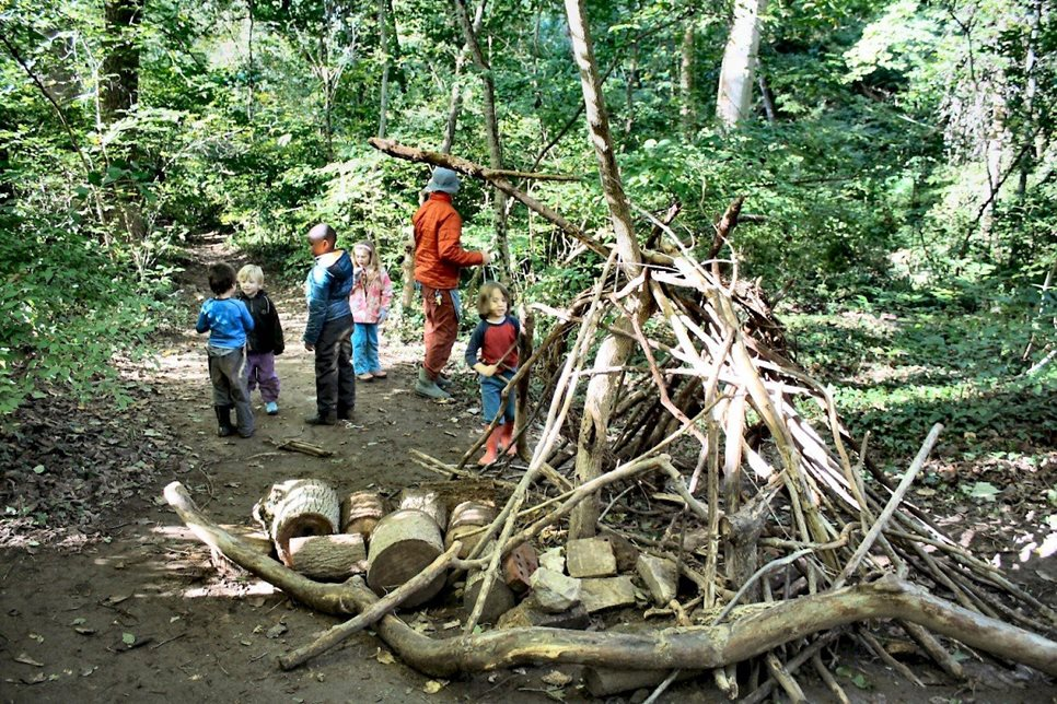 Waldorf in the Woods students spend a lot of time building forts and other structures using materials they find in the forest around them.