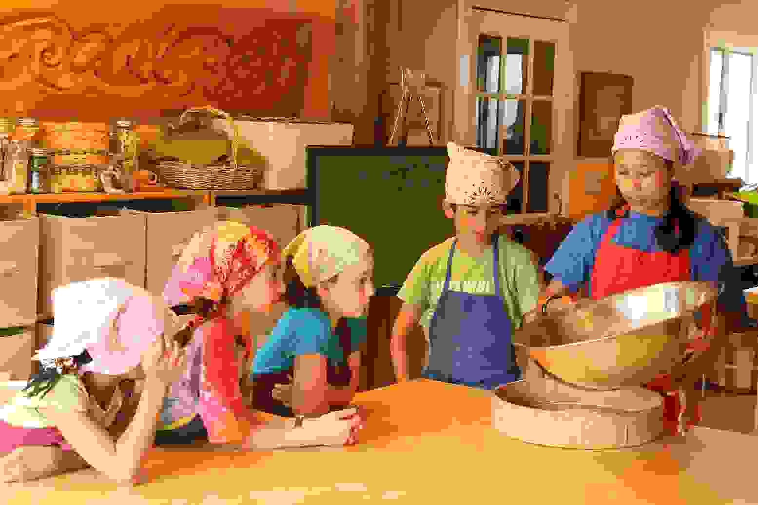 Every third-grade class visits a farm in Upstate New York for a week in the spring as part of a farming main lesson block. While there, some students work in the kitchen helping to make fresh bread.